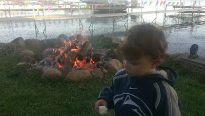 Tyler by the fire with his marshmallow