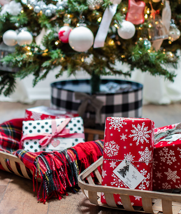 wrapped Christmas gifts in tobacco baskets