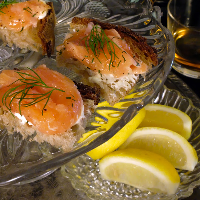 a platter of whisky-doused salmon canapés