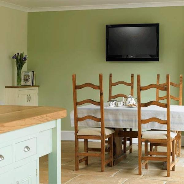 desain ruang makan dengan aksen warna hijau rancangan