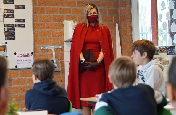 Queen Maxima wore a red coat and red sleeveless dress from Natan. Oscar de la Renta earrings