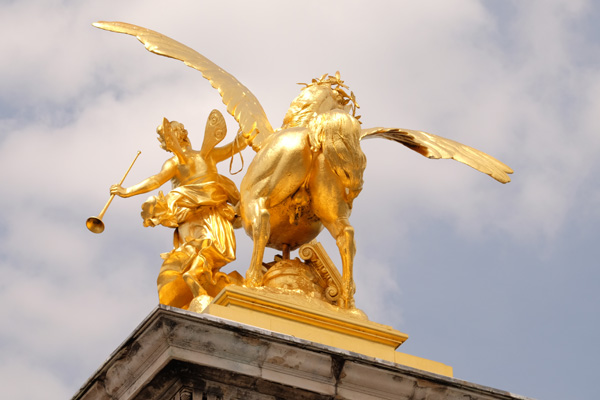 A golden winged stallion seen from behind, Pont Alexandre III. Paris photos by Kent Johnson for Street Fashion Sydney.