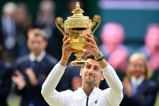 Djokovic spares match focuses to guarantee fifth Wimbledon title in the record-breaking last