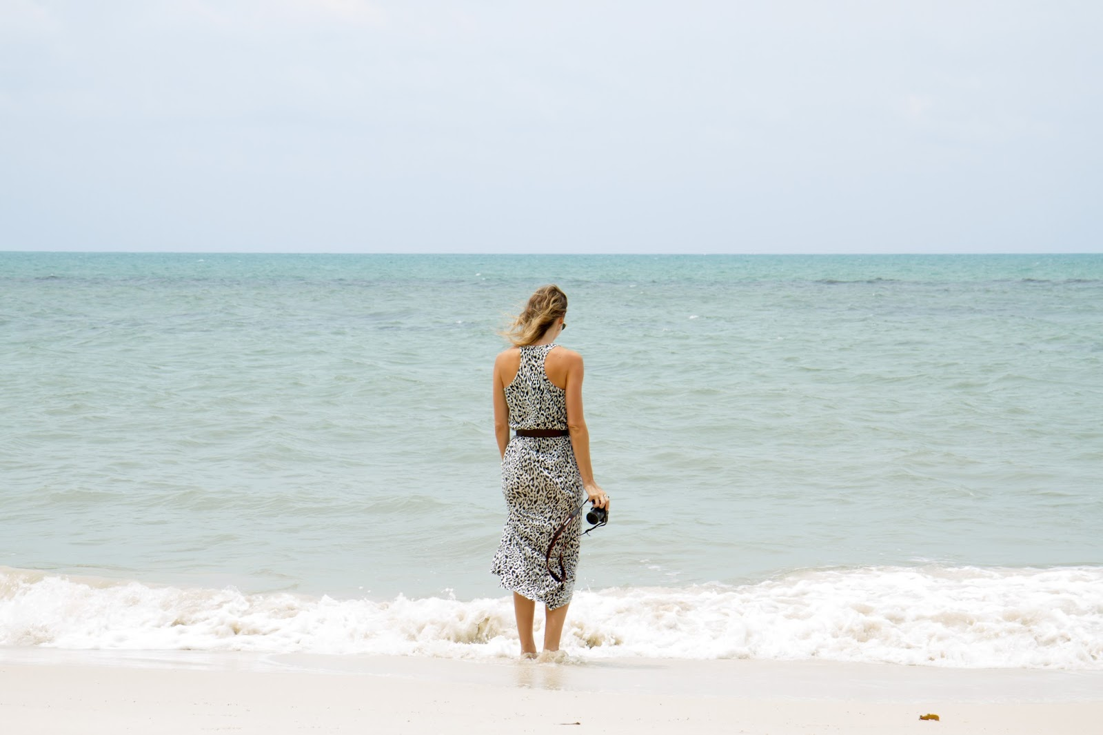travel blogger, Alison Hutchinson, on a white sandy beach in belitung