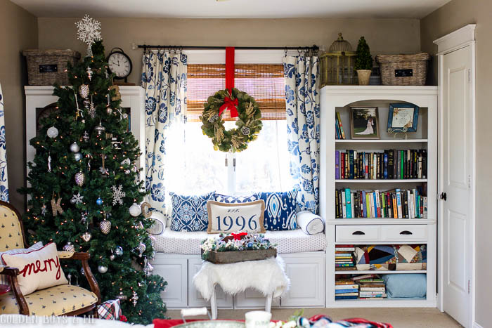 DIY window seat created with upper kitchen cabinets and repurposed wall unit with Christmas decor