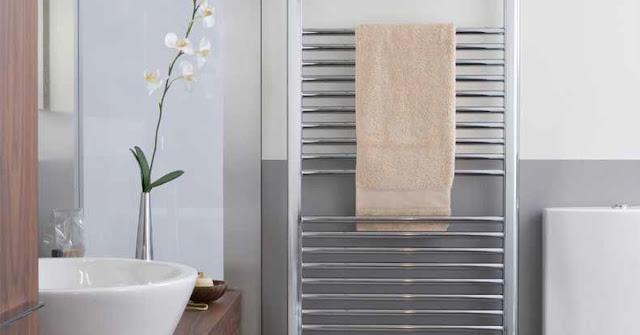 A towel warmer hung on the bathroom wall.
