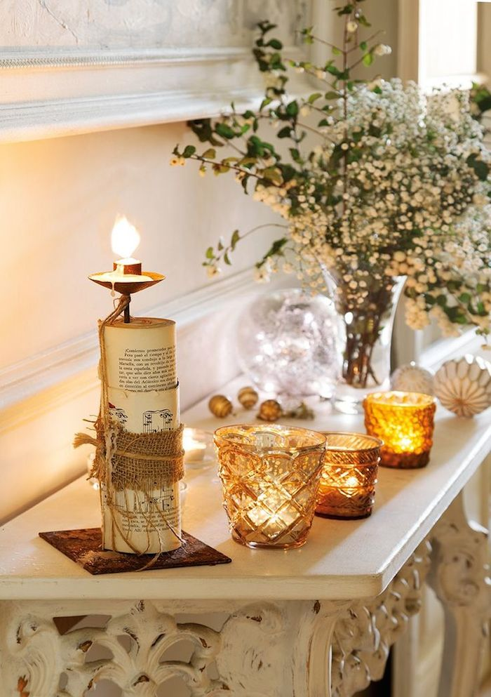 Amber glass candleholders on mantel in Paris apartment #FrenchChristmas #Parisapartment