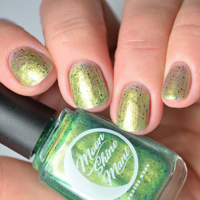 green shimmer nail polish four finger swatch