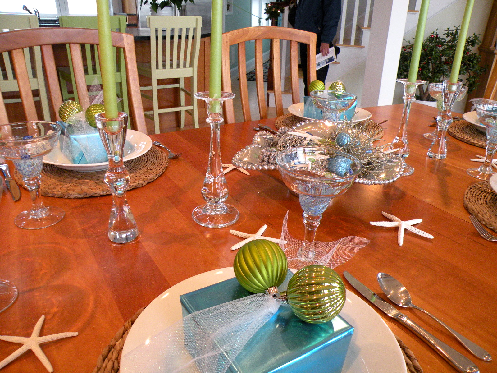 Coastal Christmas table scape with blue and green presents, ornaments and starfish