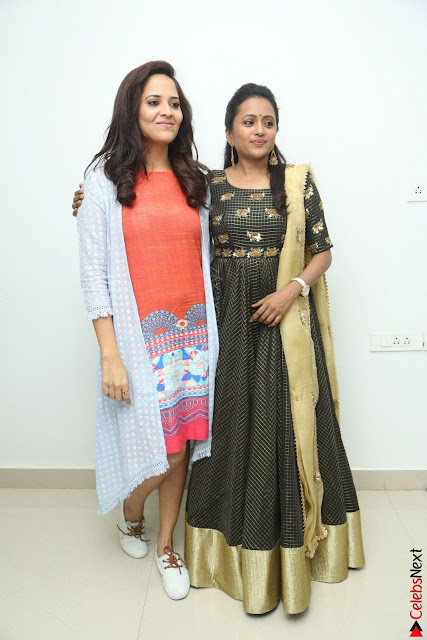 Actress Suma in Black Salwar Suit and Anusuya in orange Dress at winner movie press meet part 1 February 2017 (1).JPG