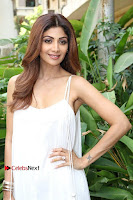 Bollywood Actress Shilpa Shetty Pos in White Gown at The Inauguration Of Shelar Make up Academy  0006.jpg
