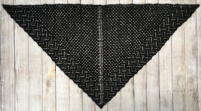 Hand-knitted black lacy shawl