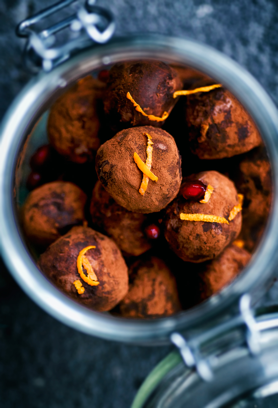 Vegan chocolate truffles with bright winter flavours of ginger, orange and pomegranate - make these as a food gift for Christmas or as a treat for yourself. These are so easy and you can't beat the taste, even though they're made with coconut cream instead of dairy.