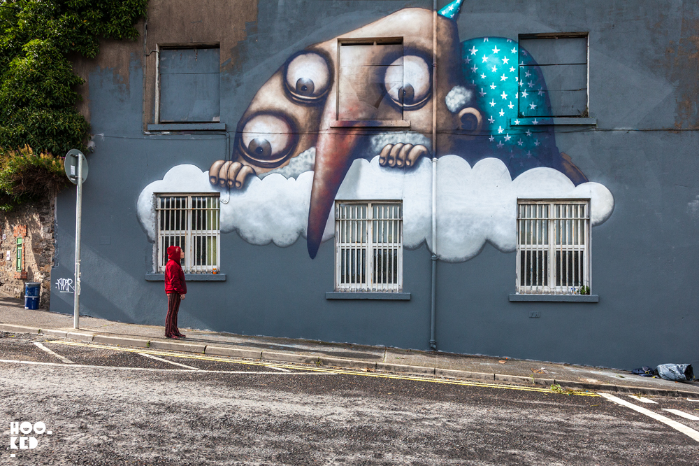 French Street Artist Ador's The Cloud Mural for Waterford Walls, Ireland.