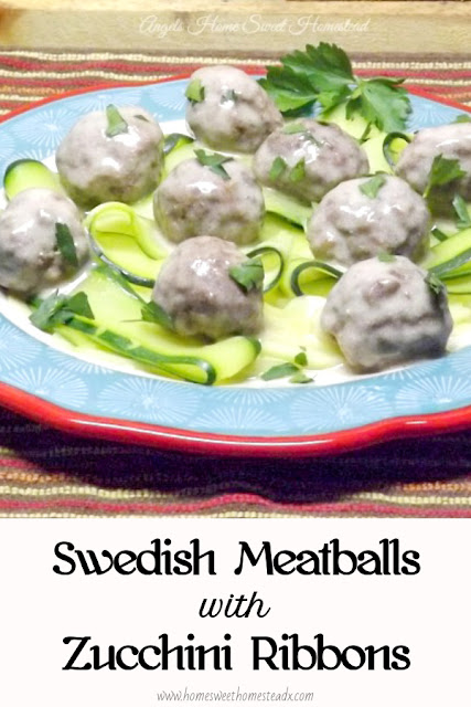 Swedish Meatballs - Home Sweet Homestead - Made with ground pork and turkey, baked, then nestled on top of zucchini ribbons, and covered in a rich and creamy beef gravy sauce.