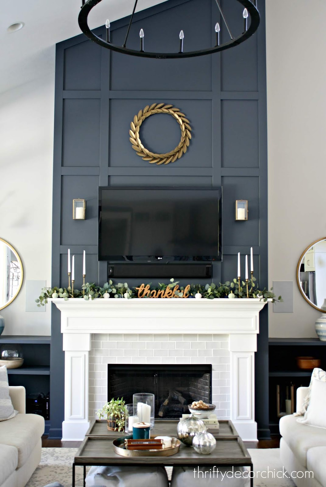 Tall dark fireplace grid wall with TV