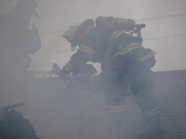 Firefighter Roof Ops During Structure Fire