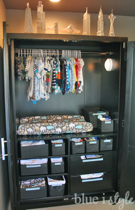armoire replaces closet for baby changing station, clothes and supplies