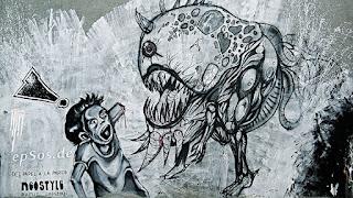 Graffiti of monster eating human