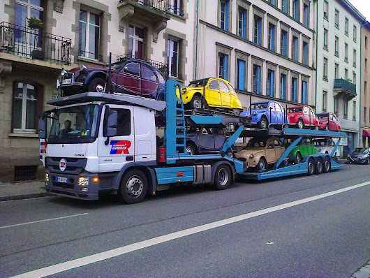 Nine Citroën 2CV on a truck