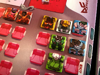 A selection of passenger tokens from Overbooked, ready for take off.