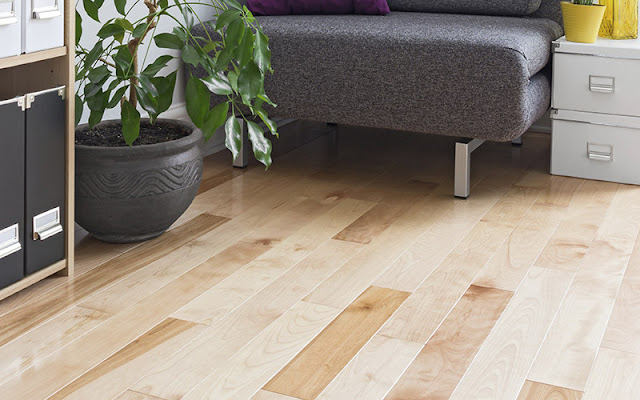 Light colored wood-like flooring is practical and pretty