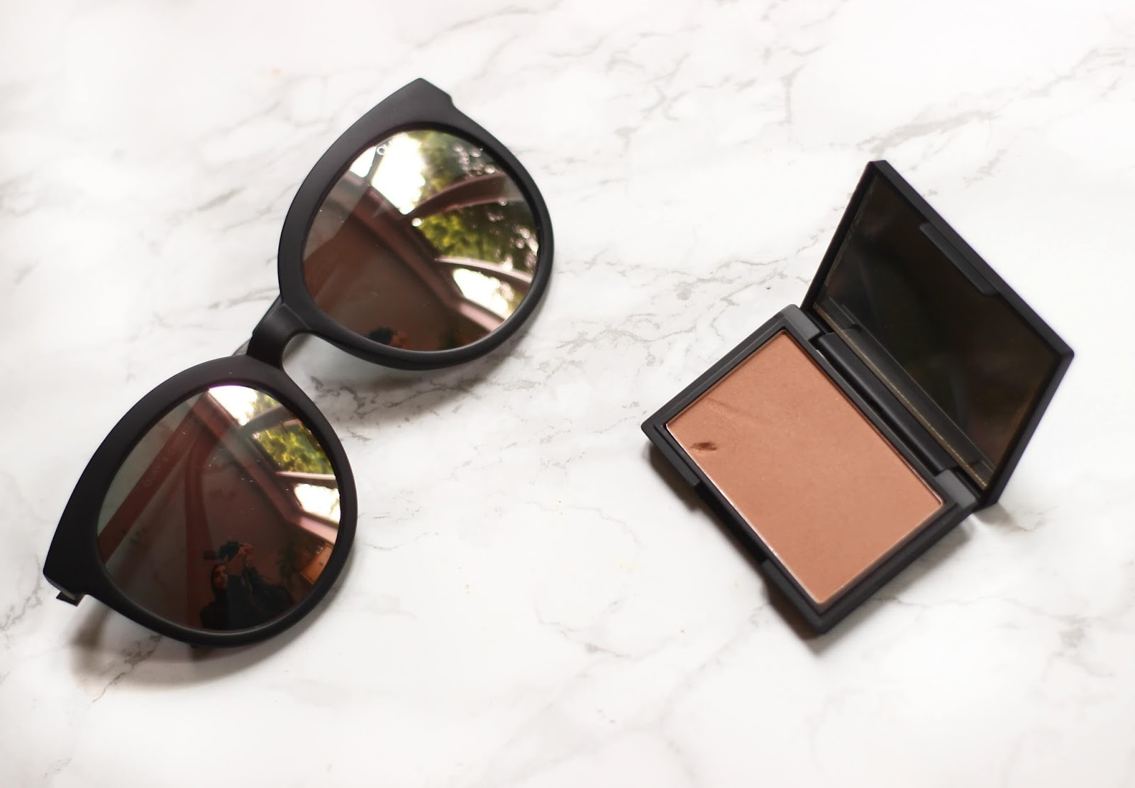quayXchrisspy jetlagged sunglasses and sleek suede blush