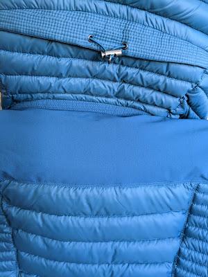 Toggle on KÜHL Spyfire Down Hoody hood (back) and softshell yoke