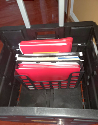 Inserting portable file containers into mobile carts
