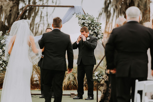 emotional groom seeing his bride