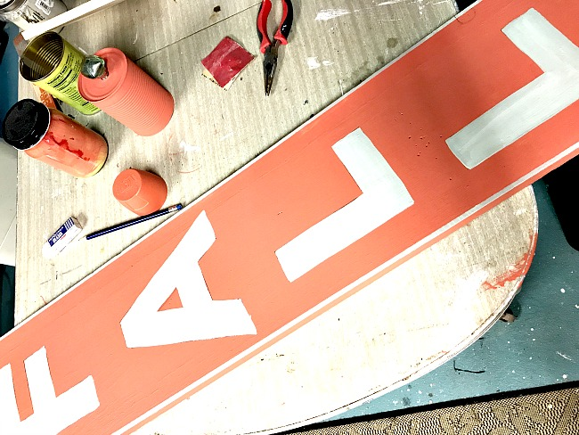 Mixing orange for a rustic vertical sign