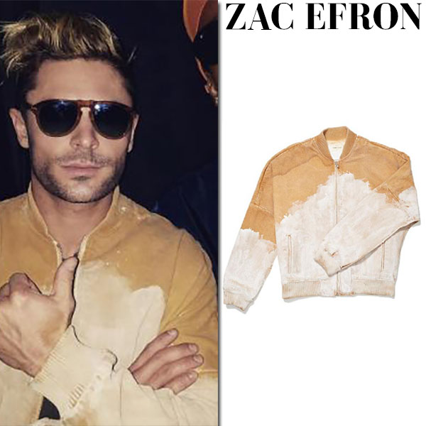 Zac Efron in mustard jacket and tortoise sunglasses
