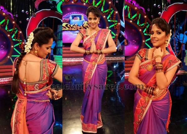 2c1e8ff745970 Telugu TV anchor Anasuya wearing purple color pure silk saree with light  orange border
