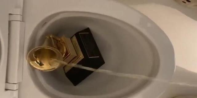 Kanye West urinates on his Grammy award (Video)