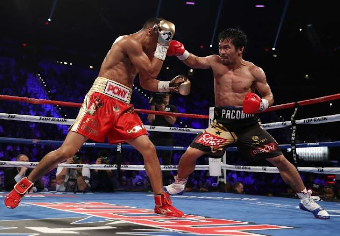 Pacquiao wins lopsided decision with Mayweather watching