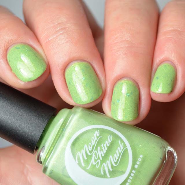 green shimmer nail polish swatch