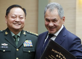 Lao and Russian Defence Ministers.  Source:  AP