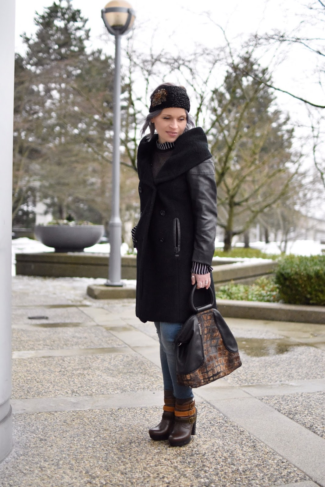 Monika Faulkner outfit inspiration - styling a shawl-collar coat with skinny jeans, platform booties, and a feather-embellished headband