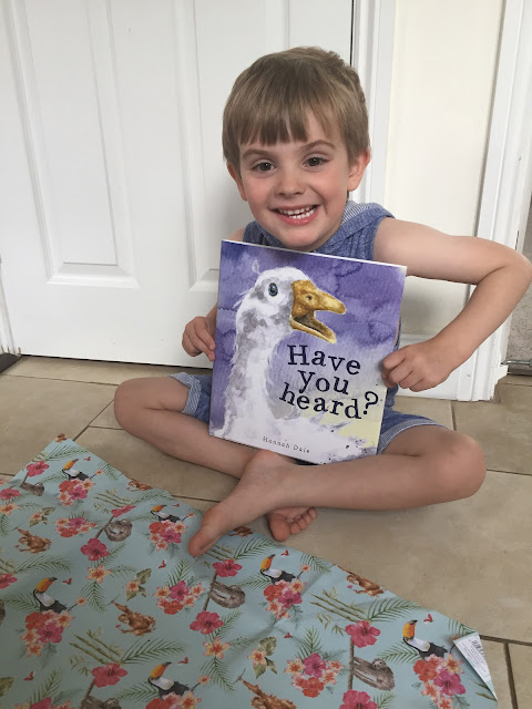 Bert Bishop with his copy of 'Have You Heard?' by Hannah Dale