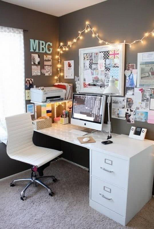 White desk and graffiti wall with ideas panel