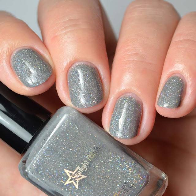 grey nail polish with holographic glitter four finger swatch