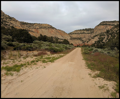 View from parking by houses. If you brave going down this road beware of how easy it is to get stuck in the soft sand.