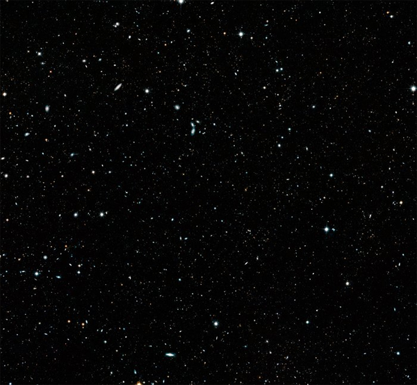 image of what looks like twinkling white stars against a dark sky, but is actually 200,000 galaxies