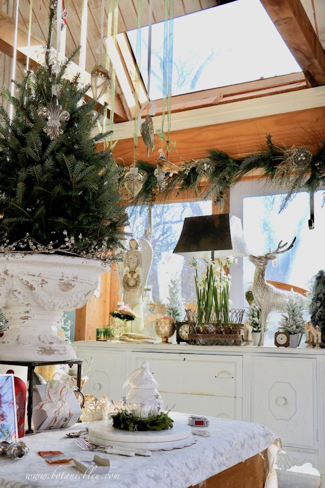 French Country Christmas Event 2019 is in the garden shed with a large skylight overlooking a Christmas tree