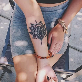 tatuaje mandala antebrazo chica