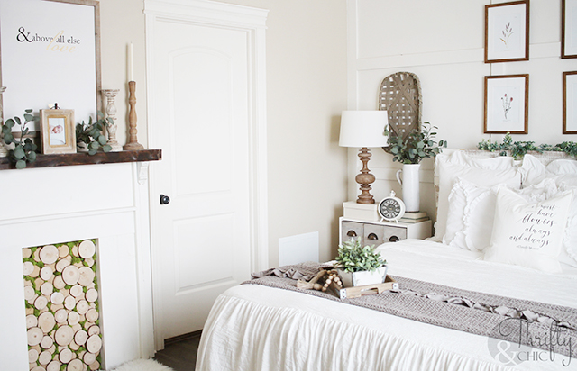 Spring bedroom decor and decorating ideas. Faux mantel and fireplace ideas. Farmhouse ruffle bedding and bedspread. Farmhouse bedroom decor. Neutral white bedroom ideas. How to decorate a bedroom. Master bedroom ideas. Farmhouse master bedroom. White bedroom decor and decorating ideas. Shabby Chic bedroom decor and ideas. Farmhouse bedding. How to make your bed. Farmhouse bedding ideas. White bedding.