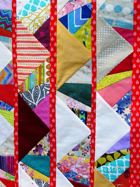 patched triangles sashed by Tula Pink betsybug red - marty mason