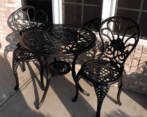 wrought iron table and chairs after painting