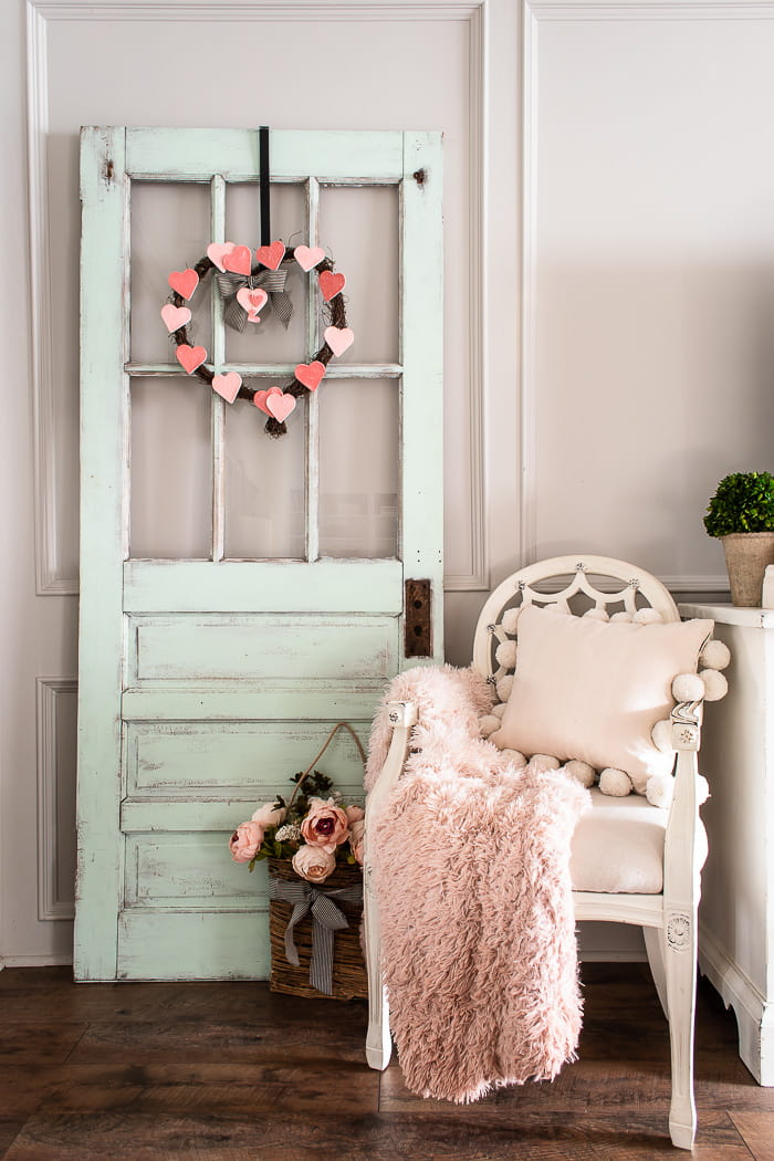 Valentines wreath hanging on antique door