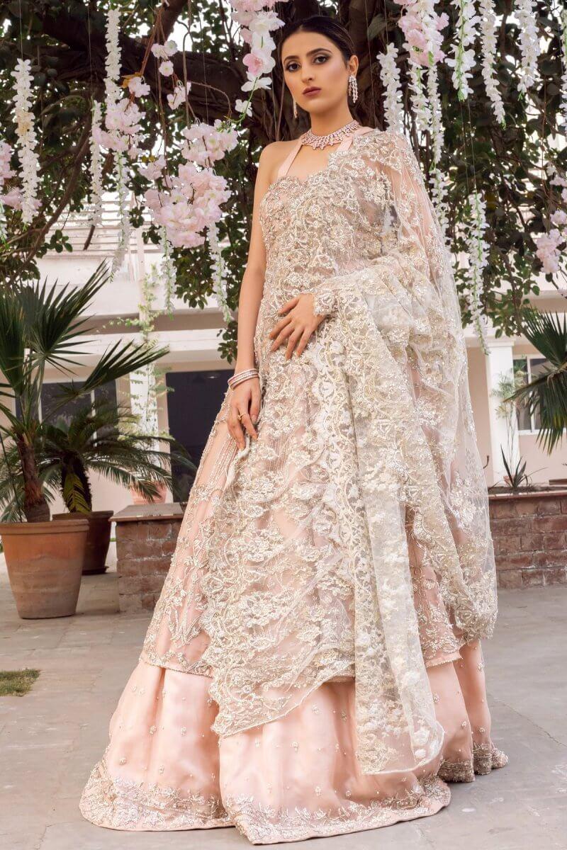 Powder pink wedding dress with shirt, lehnga and heavily embellished dupatta